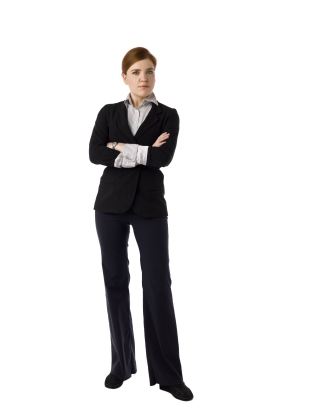 Woman standing with arms folded and looking stern
