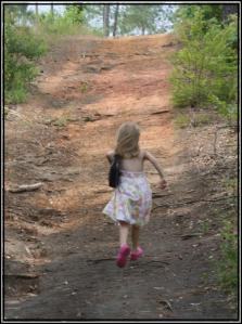 Child running up a path