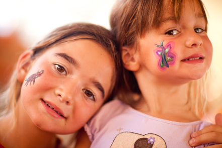 Two cute little girls with face paintings