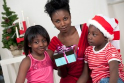 Mom with her son and daughter with Christmas gifts