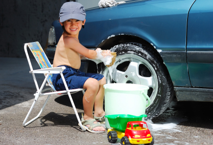 little boy washing car