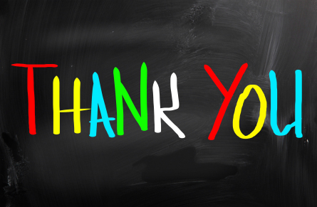"""Thank You"" on bright colors on black chalkboard"