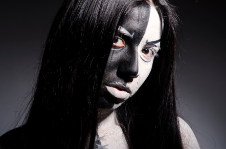 Gothic girl with half black and half white face
