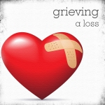 grieving a loss picture with bandaid on a heart
