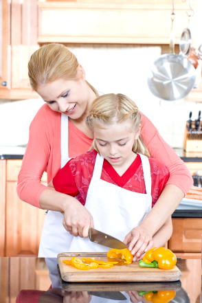 Mom cooking with daughter
