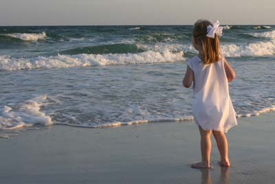 Child looking out into Gulf
