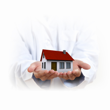 house being held in two open hands