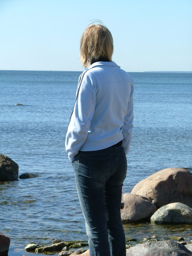 Lady looking out onto ocean