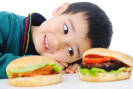 Boy eye-balling cheeseburger