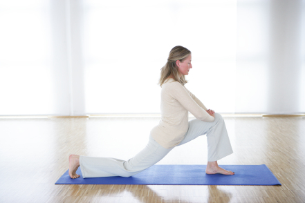 lady stretching on mat