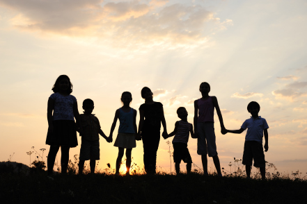 silhouette of mom and kids