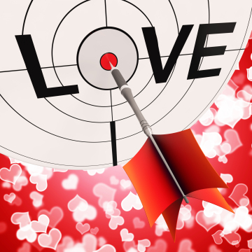 bullseye with dart hitting center of LOVE