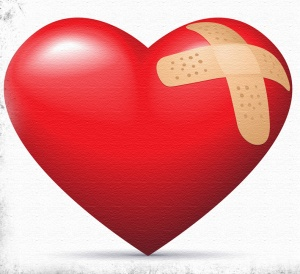 red heart with band aids across top