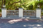 Ornamental concrete fence over bridge