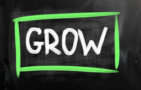 GROW with white chalk on blackboard