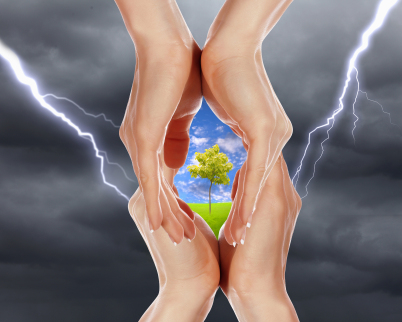 hand holding tree in midst of lightning