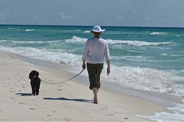 Gail walking with Prissy on beach
