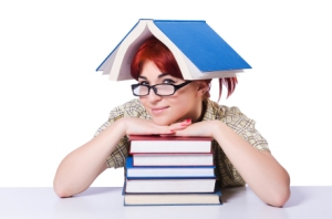 Girl with stack of books, one on her head