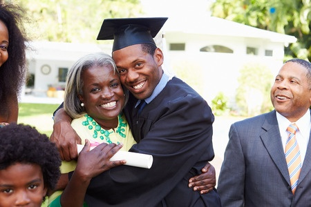 33478529 - student celebrates graduation with parents