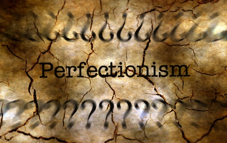 The word Perfectionism surrounded by question marks