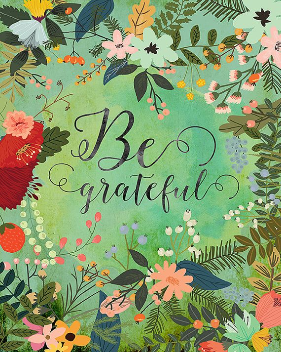 Be Grateful with swirly letters against flowery background
