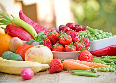 55224420 - fresh fruits and vegetables on a table - healthy diet