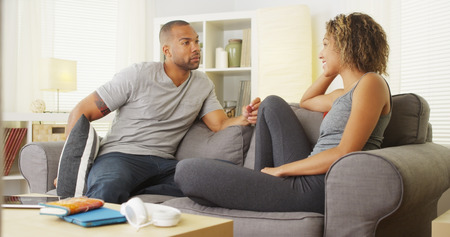 Couple having a discussion on sofa