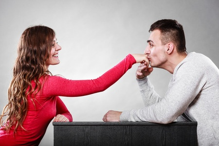 51336652 - polite man, husband kissing woman hand palm. good, happy relationship. love couple concept.