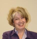 Gail smiling in purple suit