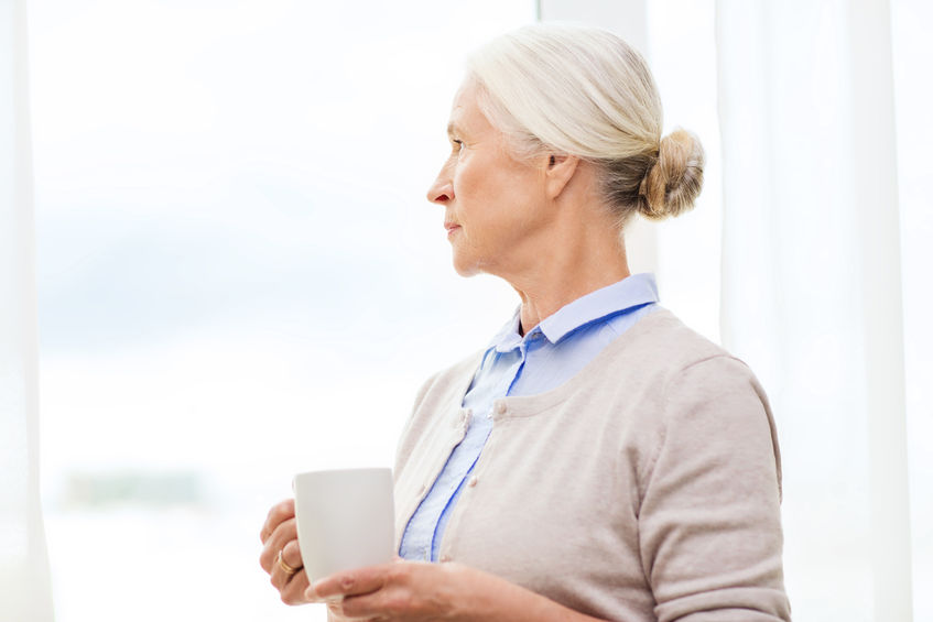 Older woman looking into distance
