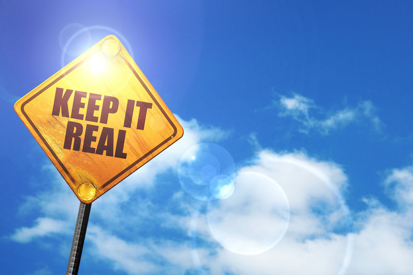 """Yellow road sign """"keep it real"""""""